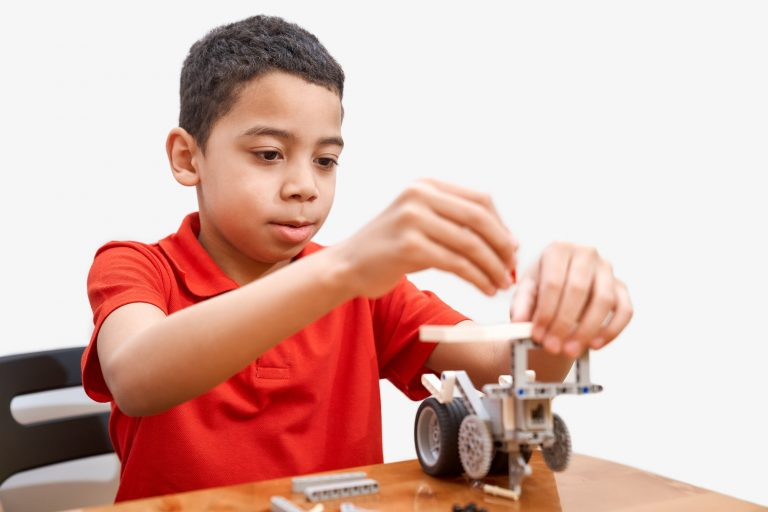African boy using building kit